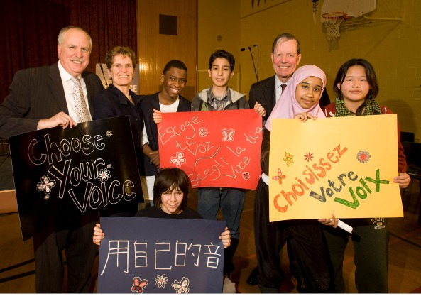 "From left to right: CEO CJC Bernie Farber, Ontario Minister of Education Kathleen Wynne, Jahlen Barnes, Sorena Sharifzedeh, FAST Founder Tony Comper, Sakinna Gairey, Renee Tran and Ezra Perlman (bottom) celebrate the success of ""Choose Your Voice"" antisemitism and antiracism education program in Toronto."