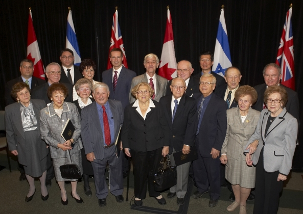 Premier Dalton McGuinty (back centre) joined the Canadian Society for Yad Vashem's National Chair, Fran Sonshine and Executive Director, Yaron Ashkenazi, to honour 12 Holocaust survivors, who have made contributions to their communities and Ontario. The Premier; the Consul General of Israel, Amir R. Gissin; Minister of Citizenship and Immigration, Michael Chan and MPP York Centre, Monte Kwinter presented each Honouree with a scroll at a Queen's Park Ceremony. Canadian Society for Yad Vashem's Hank Rosenbaum was MC.Honourees are:Fay Goldlist,Zelda Rosenfeld, Elly Gotz, Shoshana Rotenberg,Pinchas Gutter, Wolf (Bill) Rotman, Peter Jablonski,Helen Sonshine, Frida Lebovici, Edith Weiss,Jack Mudryk and Ernst Weiss