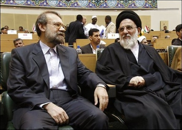 Iranian parliament speaker Ali Larijani, left, talks with Judiciary Chief Ayatollah Mahmoud Hashemi Shahroudi, in a meeting of top prosecutors from Islamic countries, in Tehran on April 21, 2009