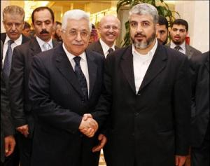 Palestinian leader Mahmud Abbas(L) shakes hands with Hamas supremo Khaled Meshaal(R)