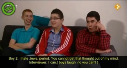 Dutch Turkish youths laugh and smile as they express hatred of Jews and love of Hitler (Nederland 2 screenshot)